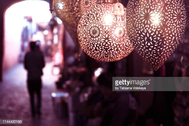metal lamps in souk, marrakech, morocco - north africa stock pictures, royalty-free photos & images