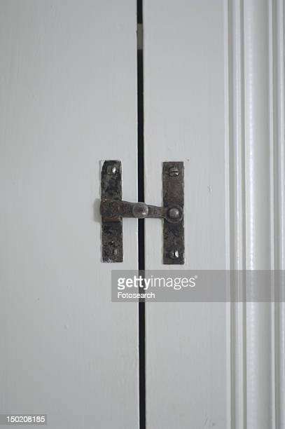 Metal latch on cabinet