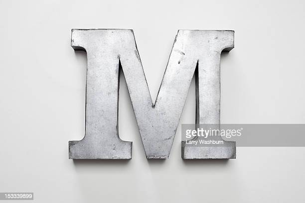 metal letter m - letter m stock pictures, royalty-free photos & images