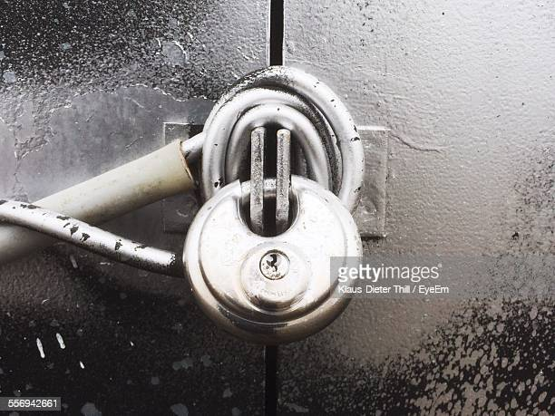 Metal Padlock Against Closed Door