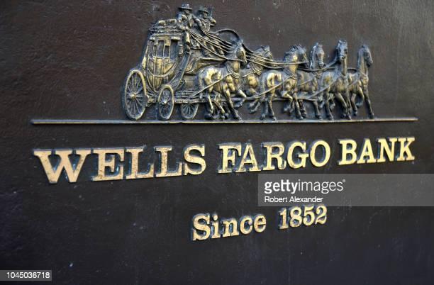 SAN FRANCISCO CALIFORNIA SEPTEMBER 13 2018 A metal plaque near the entrance to a Wells Fargo Bank building in San Francisco California