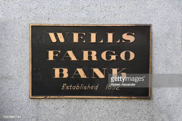 Metal plaque near the entrance to a Wells Fargo Bank in San Francisco, California, located in the historic 1910 Union Trust Company building on...