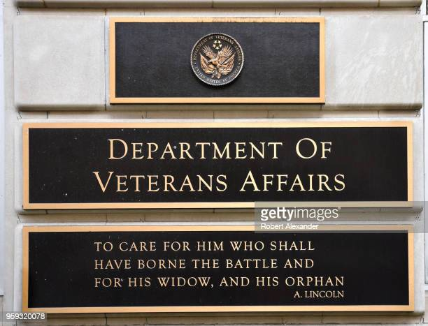 A metal plaque on the facade of the Department of Veterans Affairs building in Washington DC features a quotation by Abraham Lincoln