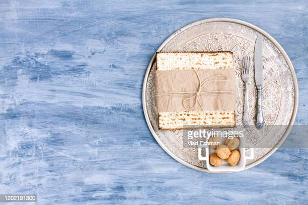 metal plate with matzah or matza - happy passover stock pictures, royalty-free photos & images