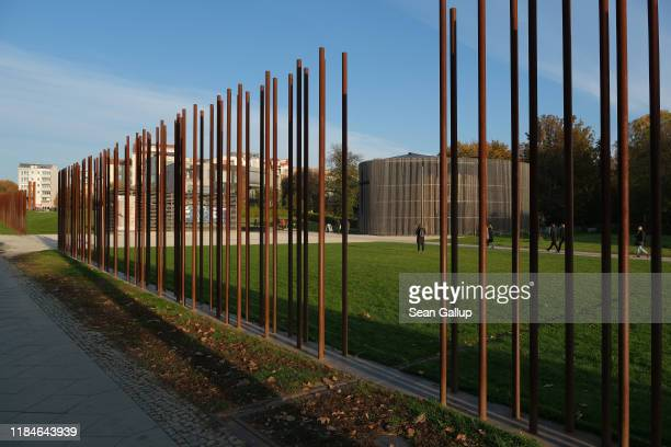 Metal poles represent where the Berlin Wall once stood at Bernauer Strasse on October 31 2019 in Berlin Germany November 9 will mark the 30th...