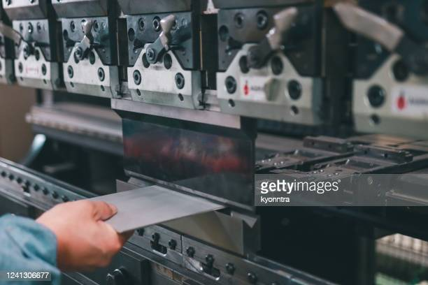 metal press machine - bending stock pictures, royalty-free photos & images