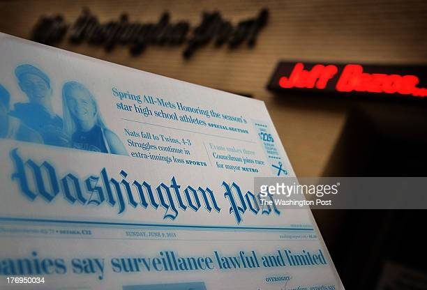 Metal printing plate of a front page with the Washington Post headquarters in the background on August 2013 in Washington, DC.