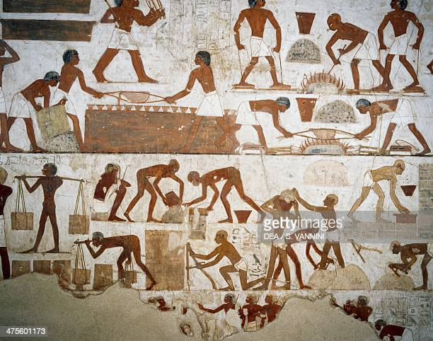 Metal processing and brick making detail from the frescoes in the Tomb of Rekhmire Sheikh Abd el Qurnah Necropolis Luxor Thebes Egypt Egyptian...