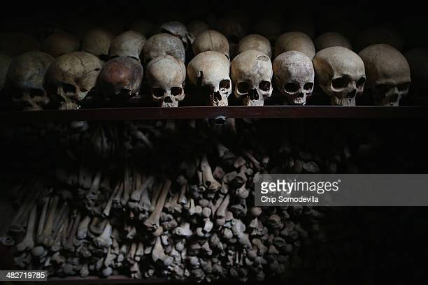 Metal racks hold the bones of thousands of genocide victims inside one of the crypts at the Nyamata Catholic Church memorial ahead of the 20th...