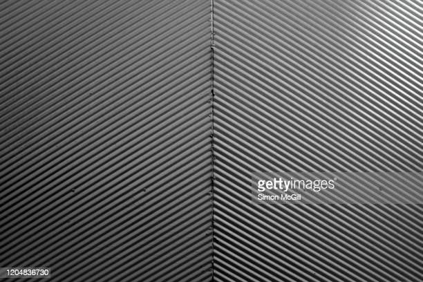 metal security gate with slanting parallel line pattern - metal stock pictures, royalty-free photos & images
