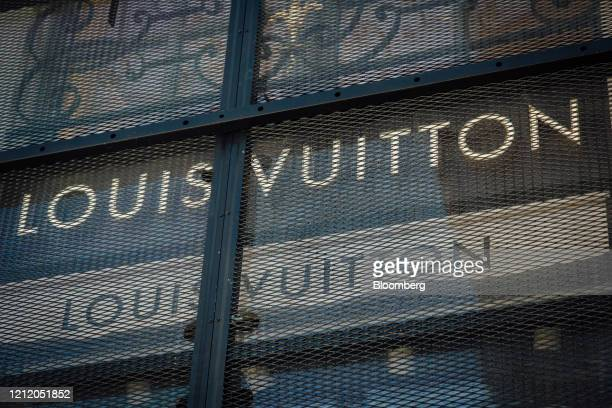 Metal security grilles protect the Louis Vuitton luxury goods store operated by LVHM Moet Hennessy Louis Vuitton SE on Place Vendome in Paris France...