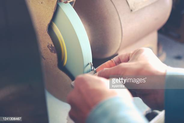 metal sharpening - kyonntra stock pictures, royalty-free photos & images
