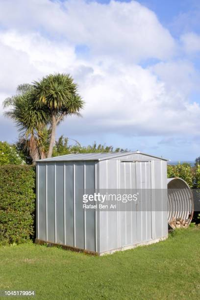 metal shed and firewood storage container in backyard - rafael ben ari bildbanksfoton och bilder