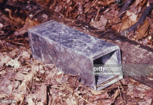 Metal Sherman animal trap set among leaves used to capture animals during an arbovirus field study 1974 Testing animals is important for the control...