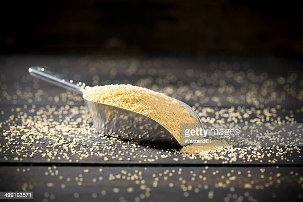metal shovel of millet on dark wood - millet stock pictures, royalty-free photos & images