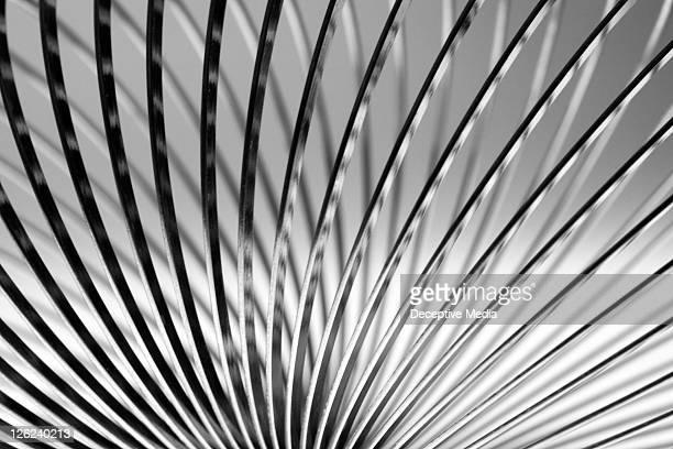 metal slinky - flexibility stock pictures, royalty-free photos & images