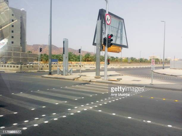 metal speed breaker bumps and traffic signals on city road - bumpy stock photos and pictures