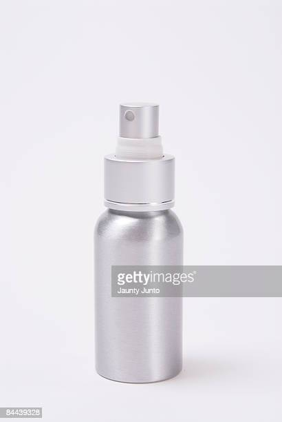 metal spray bottle on white background