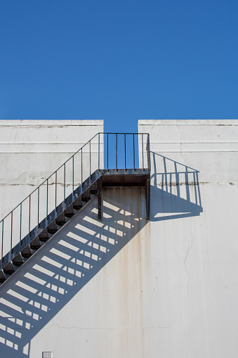 Metal staircase on outside wall - gettyimageskorea