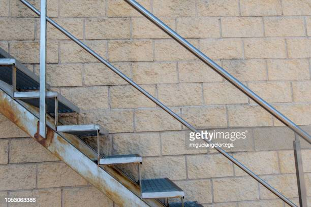 metal stairs with fence - railing stock pictures, royalty-free photos & images