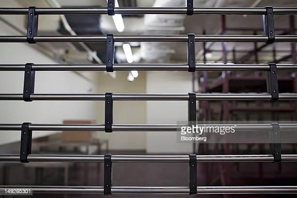 Metal storage racks are seen through the door to a vault at the MalcaAmit Global Ltd gold storage facility in Hong Kong China on Monday July 23 2012...