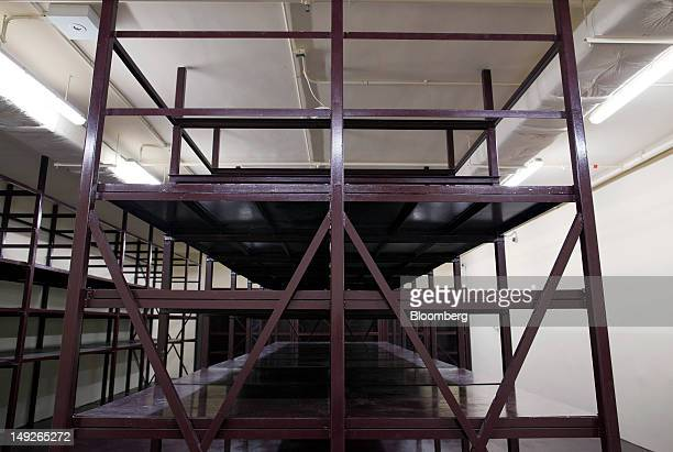 Metal storage racks stand in a vault at the MalcaAmit Global Ltd gold storage facility in Hong Kong China on Monday July 23 2012 Hong Kong's largest...