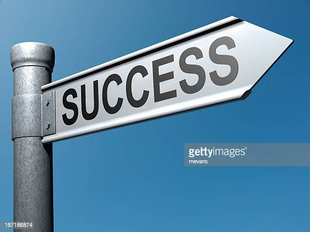 Metal street pole with success sign on blue background