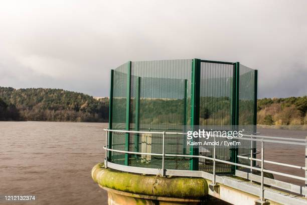 metal structure by river against sky - football bulge stock pictures, royalty-free photos & images