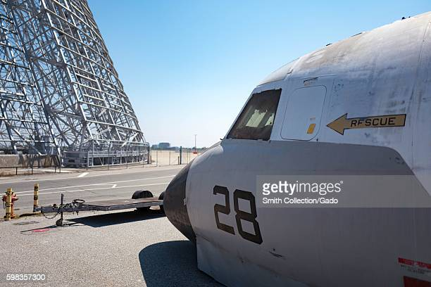 Metal structure of Hangar One is visible along with the nose portion of a military plane on exhibit at the Moffett Field Historical Museum within the...