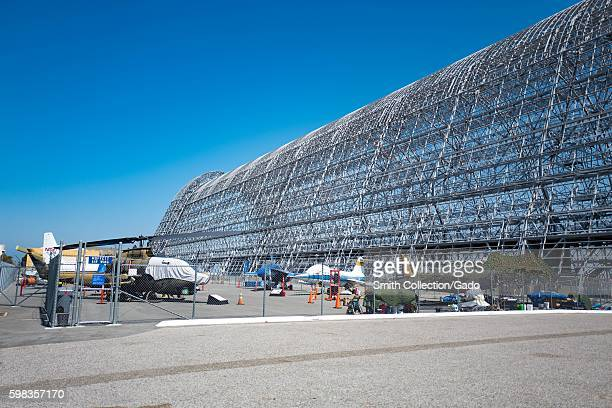 Metal structure of Hangar One with historical aircraft displayed in the foreground within the secure area of the NASA Ames Research Center campus in...