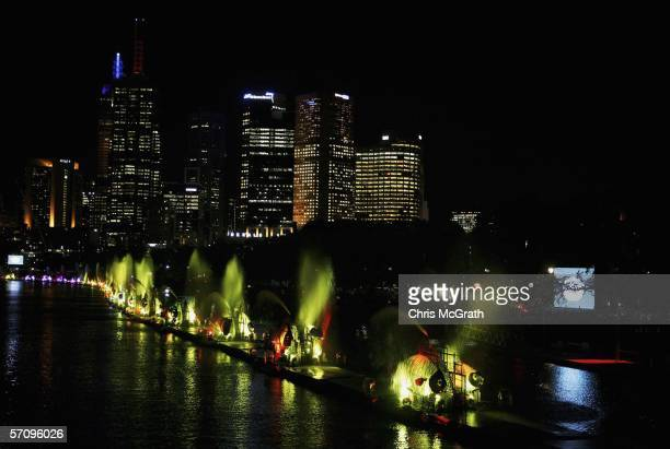Metal structures shaped as fish are illuminated along the river during the Opening Ceremony for the Melbourne 2006 Commonwealth Games on the Yarra...