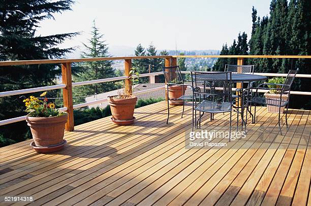 metal table and chairs on deck - patio stock pictures, royalty-free photos & images