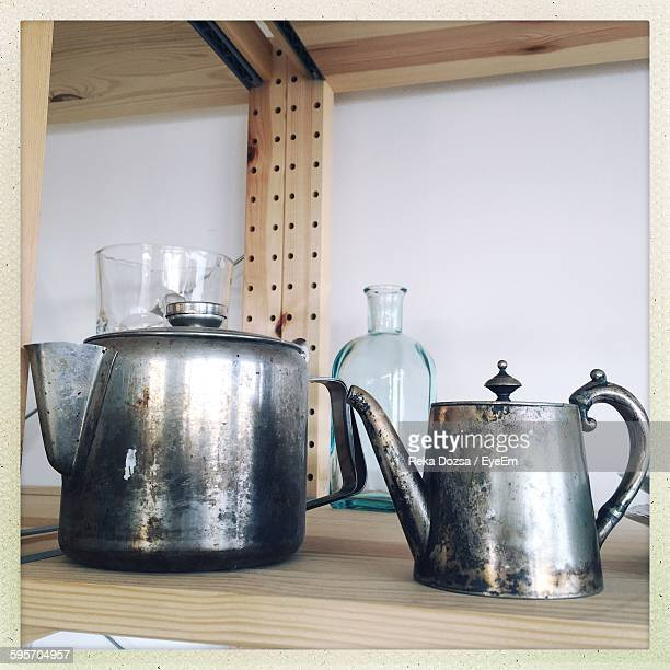 Metal Teapots On Wooden Shelf