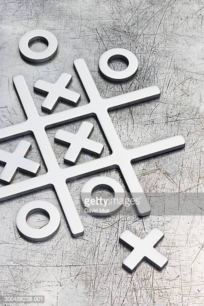 Metal, three dimensional Naughts and crosses game, close-up