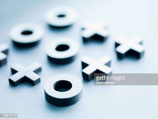 metal tic-tac-toe game pieces - strategy stock photos and pictures