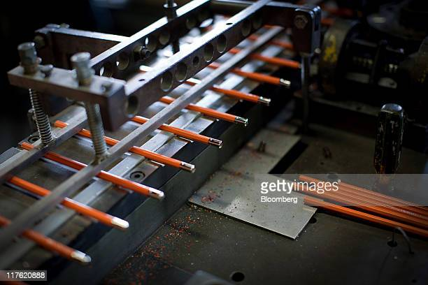 Metal tips are attached to pencils by machine at the General Pencil Co's factory in Jersey City New Jersey US on Wednesday June 22 2011 General...