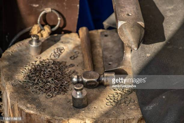 metal tools. anvil, hammer, jewelry weight, metal rings. workplace artisan. reconstruction of old crafts. chain mail manufacture. - rpg maker stock pictures, royalty-free photos & images