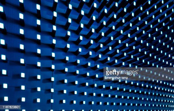 metal wall with reflected by yellow lights - wall building feature stock pictures, royalty-free photos & images