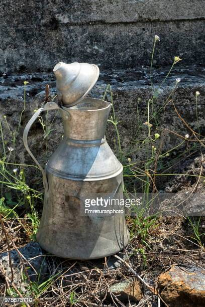 metal water pitcher in the field. - emreturanphoto stock pictures, royalty-free photos & images