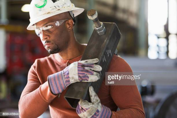 metal worker in fabrication plant - black glove stock pictures, royalty-free photos & images