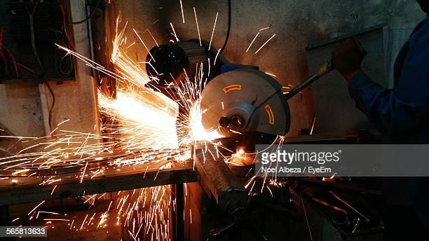 metal worker operating machinery - circular saw stock photos and pictures