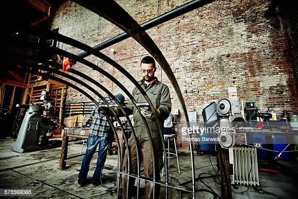 Metal worker preparing to install bracing