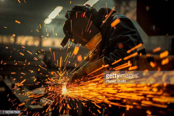 metal worker using a grinder - sparks stock pictures, royalty-free photos & images