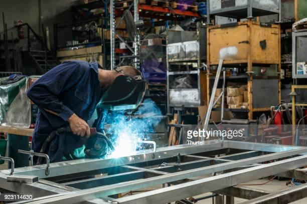 Metal Worker Welding In Factory