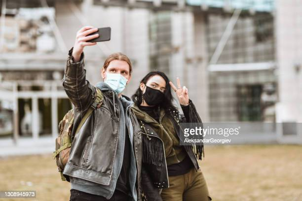 metalhead couple sightseeing modern city center - punk music stock pictures, royalty-free photos & images