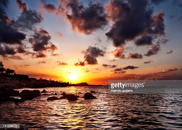 metalic sunset - denia stock pictures, royalty-free photos & images