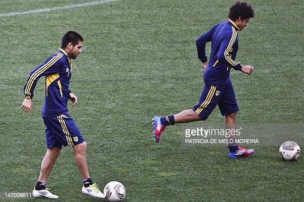 Metalist Kharkov's Argentinian defender Cristian Villagra and Brazilian forward Taison take part in a training session at Alvalade Stadium in Lisbon...