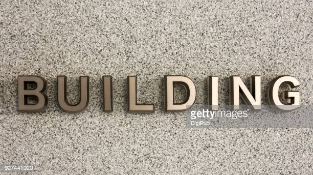 Metallic 3D sign on the wall