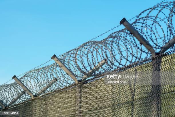 Metallic Fence Against Clear Blue Sky