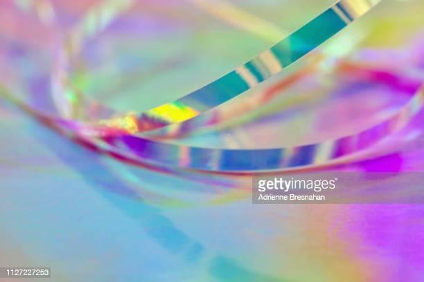 metallic foil ribbon and pastel light effects - リフレクター ストックフォトと画像